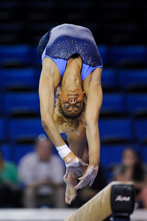 . UCLA\'s Danusia Francis practices on the beam. (Michael Owen Baker/Staff Photographer)