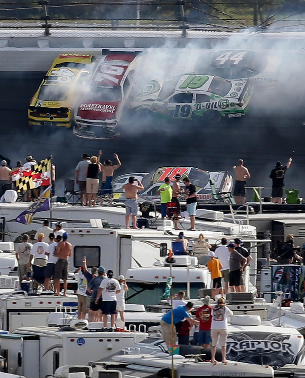 . Race fans watch as cars, including Michael Annett (43), Johanna Long (70), Mike Bliss (19), and Hal Martin (44), crash during the NASCAR Nationwide Series auto race Saturday, Feb. 23, 2013, at Daytona International Speedway in Daytona Beach, Fla. (AP Photo/Chris O\'Meara)