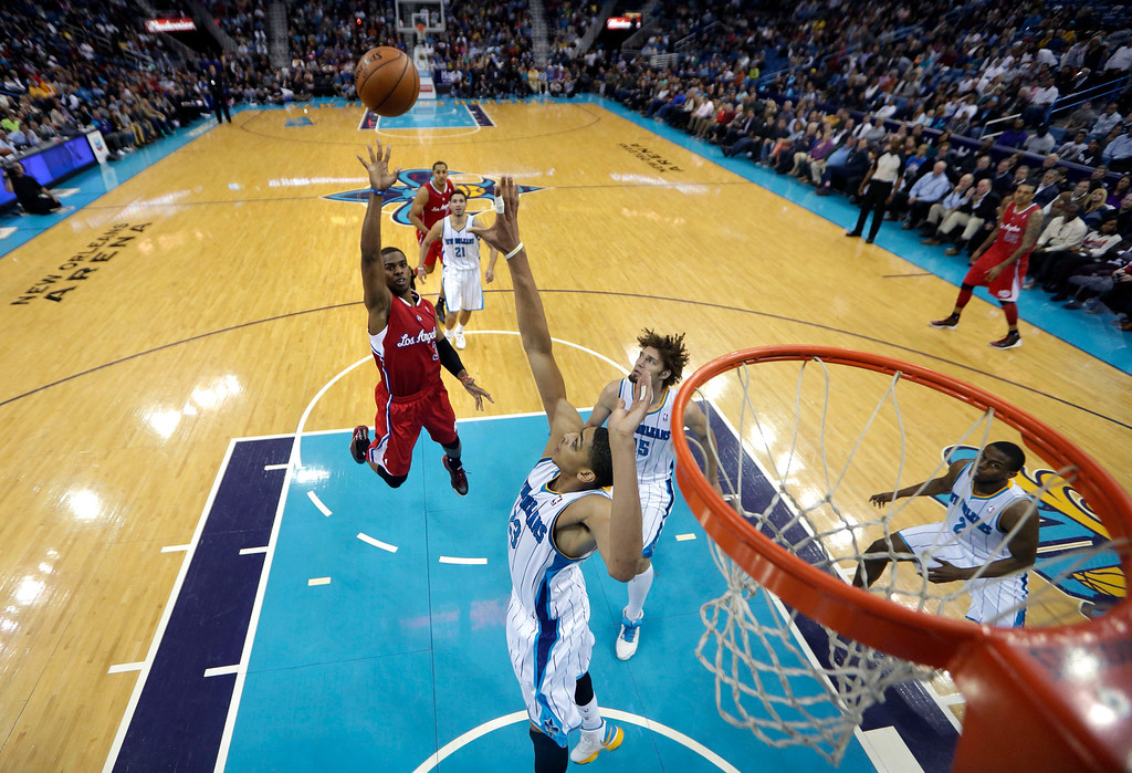 . Los Angeles Clippers point guard Chris Paul (3) shoots over New Orleans Hornets power forward Anthony Davis (23) and Los Angeles Clippers center Ryan Hollins (15) in the second half of an NBA basketball game in New Orleans, Wednesday, March 27, 2013. The Clippers won 105-91. (AP Photo/Gerald Herbert)