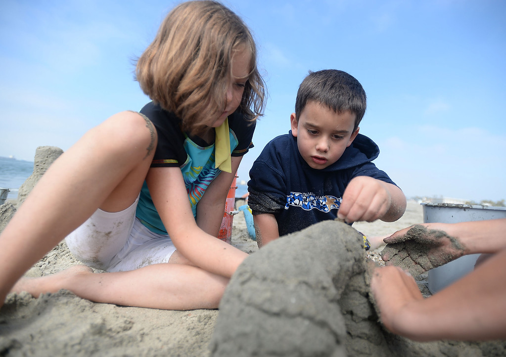 . Children had a chance to hone their sand castle building skills in a sand castle camp Monday at Granada Beach in Belmont Shore. Kathryn Sheridan and Zack Granit add to a double arch while trying to keep it from collapsing. 20130805 Photo by Steve McCrank / Staff Photographer
