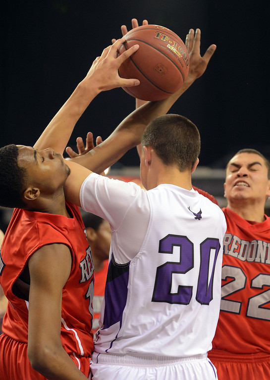 . Redondo Union High School\'s Cameron High tries to grab a rebound against Trevor Larnach of College Park High School during the Division II 2013 CIF State Basketball Championships at Sleep Train Arena, in Sacramento, Ca March 23, 2013.  Redondo won the game 54-47.(Andy Holzman/Los Angeles Daily News)