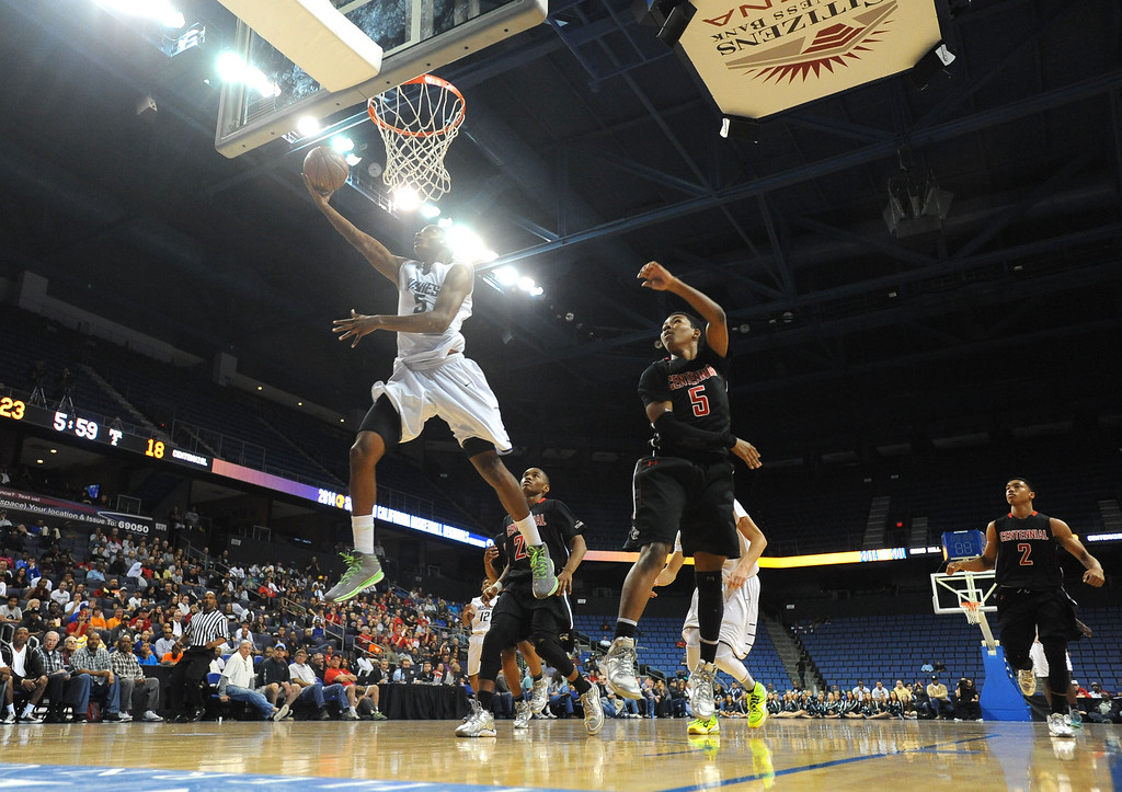 . Chino Hills\' Bishop Mency scores at Citizens Business Bank Arena in Ontario, CA on Saturday, March 22, 2014. Chino Hills vs Centennial in the CIF boys Div 1 regional final. 1st half. Photo by Scott Varley, Daily Breeze)