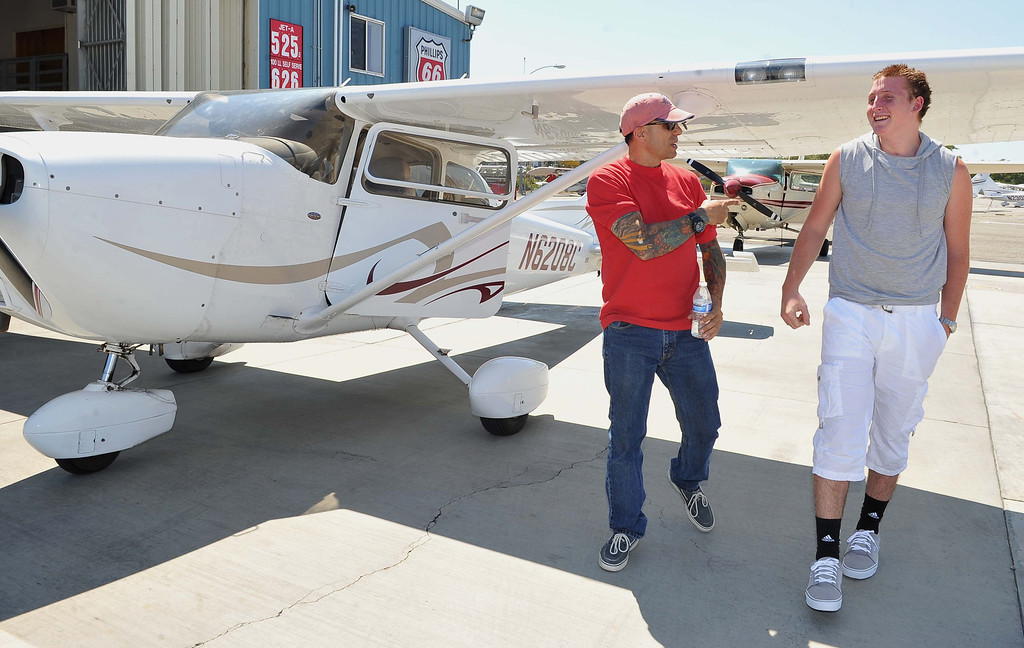 ". 8/21/13 -  After flyng Trevor Schultheis, 16, gets a praise for a job well done from pilot Erik Radcliffe. Pediatric rehabilitation patients from Miller Children�s Hospital Long Beach got experience their first �Discovery Flight� at the California Flight Center. After some training from the pilots the kids got to actually pilot the plane on their own. The program which uses volunteer pilots has taken 125 kids in the air. Schultheis  favorite part of flying is, ""the feeling of control over something so large.\"" Photo by Brittany Murray, Press Telegram"