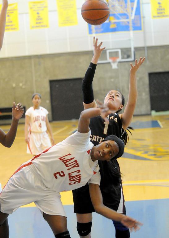 . 03-12-2013--(LANG Staff Photo by Sean Hiller)-Serra\'s Kayla Bibb (2) battles JSerra\'s Coco Miller (1) in Tuesday\'s girls basketball IV Southern California Regional semifinal at L.A. Southwest College.