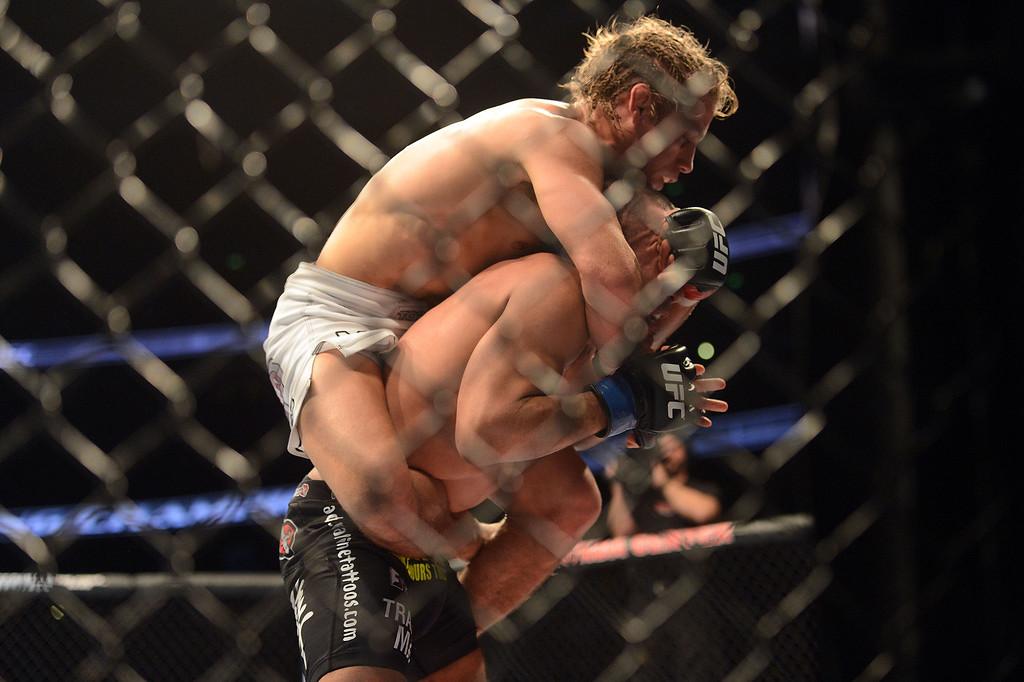 . Urijah Faber sets up a rear-naked choke on  Ivan Menjivar during their UFC 157 match at the Honda Center in Anaheim Saturday, February  23, 2013.  Faber beat Menjivar via 1st round rear-naked choke submission. (Hans Gutknecht/Staff Photographer)