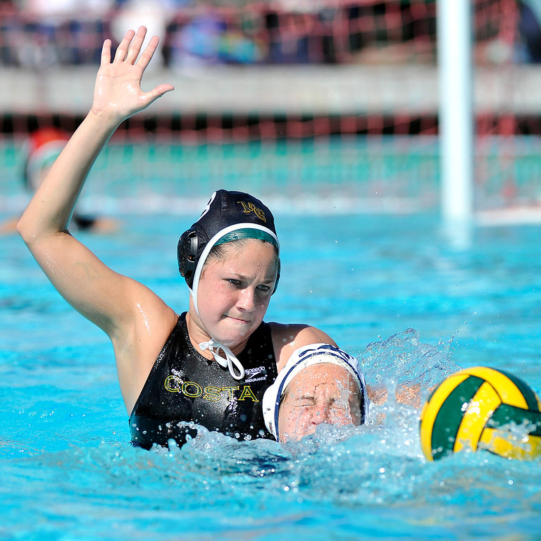 . MANHATTAN BEACH - 2/16/2013 - (Mark Savage) GIRLS WATER POLO: Arroyo Grande at Mira Costa. CIF Southern Section Division III quarterfinal. Mira Costa player #8 Isabella Magno reaches for the ball over Arroyo Grande player #13 Melanie Popovich during the second half.