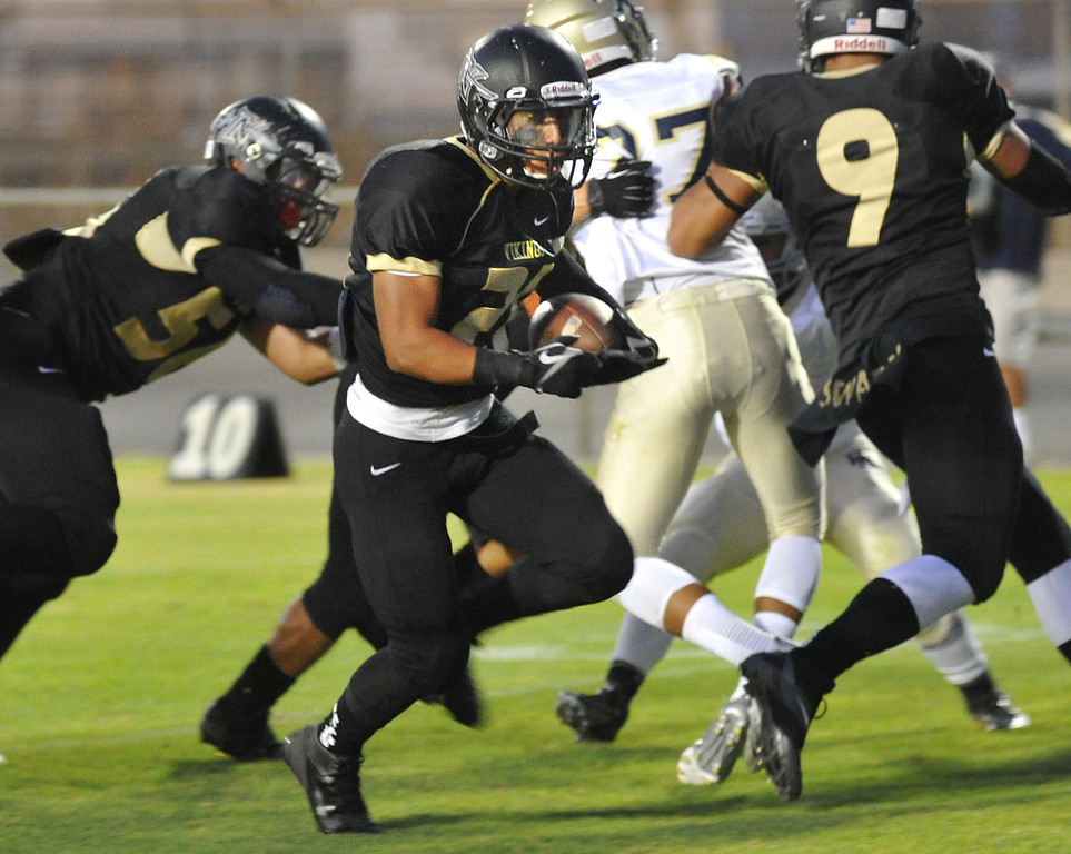 Description of . Northview's Nicholas Ybarra #21) runs in for a touchdown as they play Rowland in their non-league game at Covina District Field in Covina on Friday September 13, 2013.  (San Gabriel Valley Tribune/Staff Photo by Keith Durflinger)