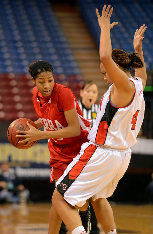 . Serra High School\'s Caila Hailey looks to pass as Mariya Moore of Salesian High defends during the Division IV 2013 CIF State Basketball Championships at Sleep Train Arena, in Sacramento, Ca March 23, 2013.  Serra won the game 62-60.(Andy Holzman/Los Angeles Daily News)