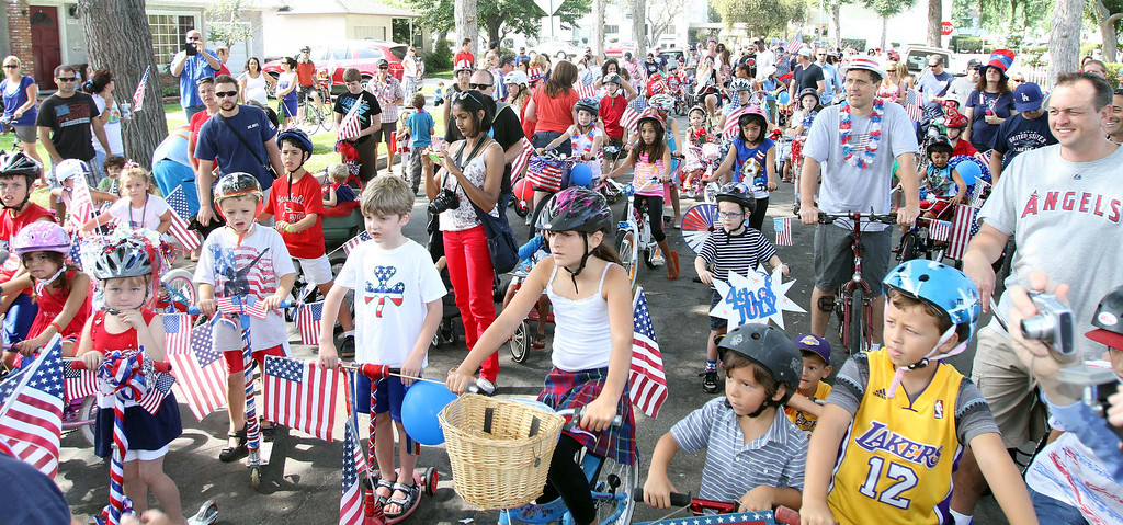. July 4, 2013-Photo by Tracey Roman/for the Press-Telegram  The kids packed the street of the East Long Beach neighborhood to participate in the annual 4th of July Bike Parade which started years ago by The Stone Family, Simon and Kari, and a neighbor.