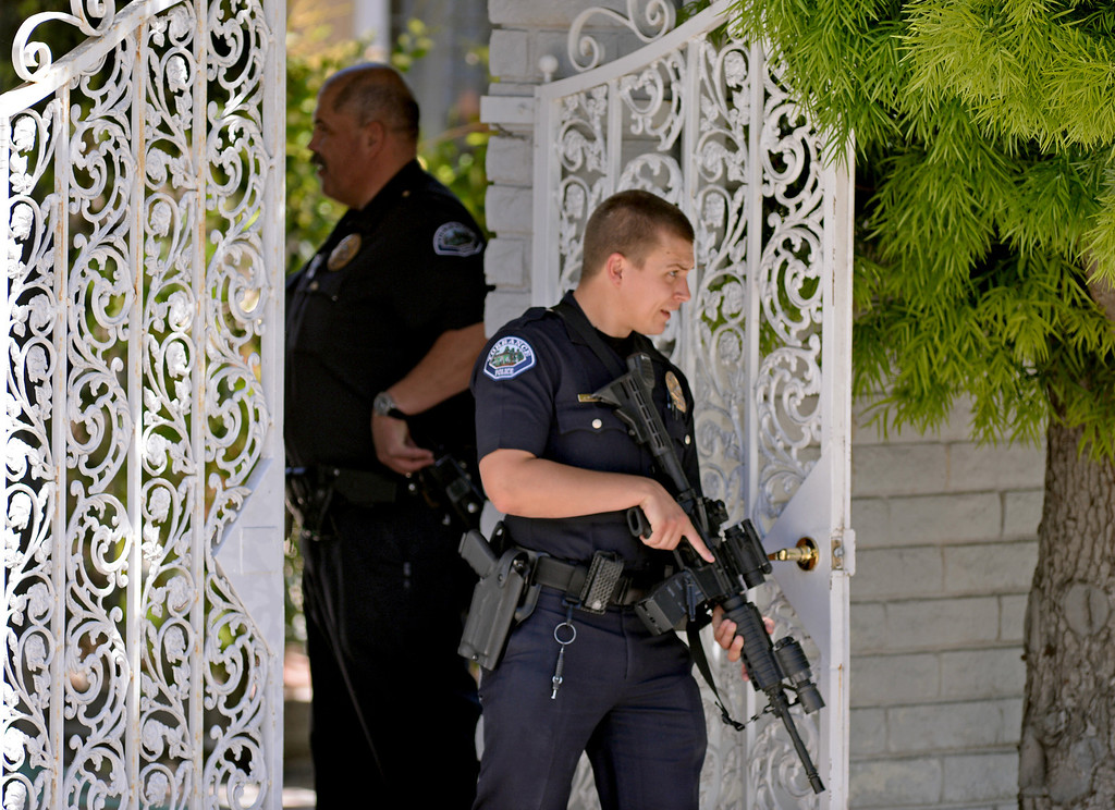 . Torrance PD officers converged en mass to the 3900 block of Mesa Street on Friday after a call came in refering to a shooting at State Senator Ted Lieu\'s home. It turned out to be a prank call at about 1p.m. Photo by Brad Graverson 4-19-13
