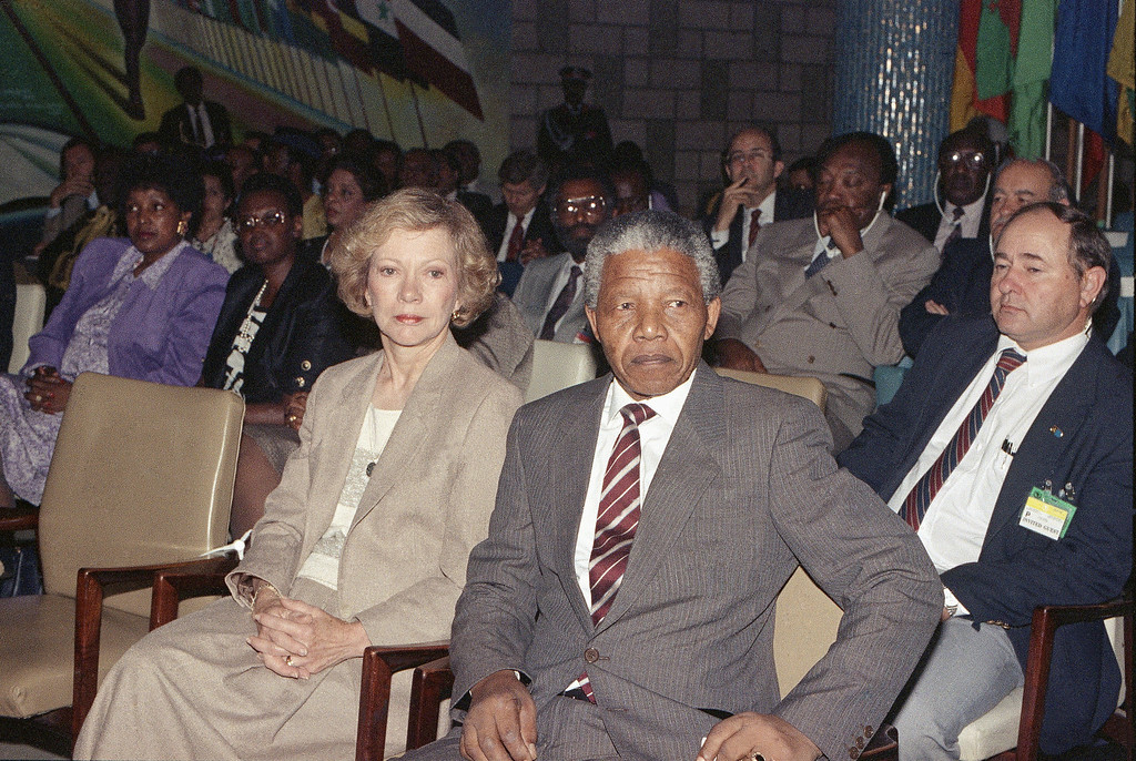 . ANC leader Nelson Mandela sits next to former first lady Rosalynn Carter during the 26th summit of the Organization of the African Unity, Tuesday, July 11, 1990 in Addis Ababa. (AP Photo/Aris Saris)
