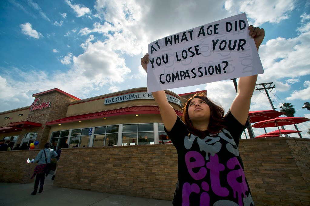 Description of . PETA member Alyssa Silva, 20, protests outside of Chick-fil-a during its grand-opening across from Azusa Pacific University in Azusa on Thursday, Feb. 21, 2013 (SGVN/Staff photo by Watchara Phomicinda)