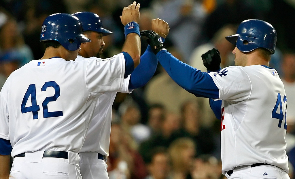 Description of . After hitting a homer in the bottom of fifth inning, Dodgers\' Jeff Kent, right, high-fives his teammates in a game against the Pittsburgh Pirates on Tuesday, April 15, 2008 at Dodger Stadium. The Dodgers won 11-2. (John Lazar/L.A. Daily News Staff Photographer)