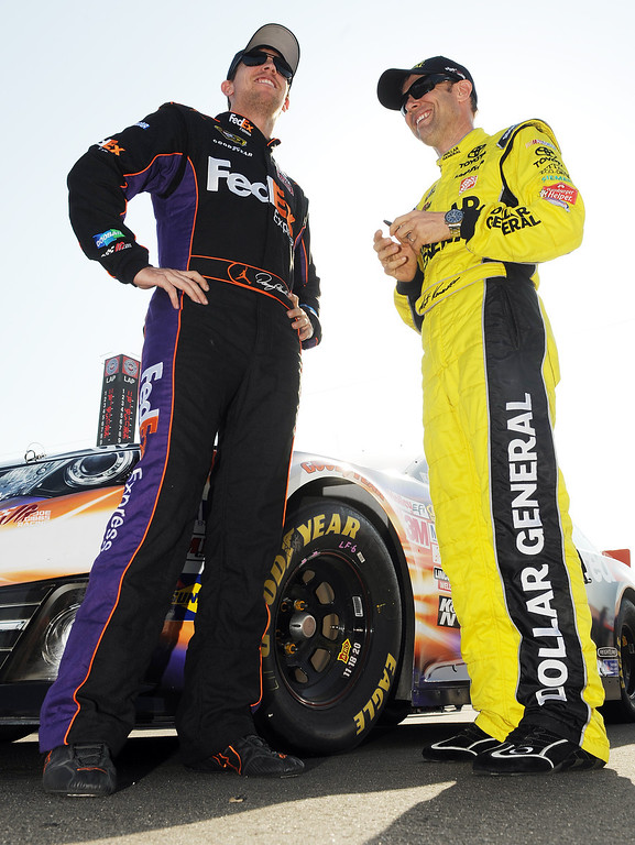 . (Will Lester/Staff Photographer) NASCAR driver Denny Hamlin (left) speaks with Matt Kenseth (right) after qualifying Friday. Hamlin won the pole position for Sunday\'s Auto Club 400 Friday March 22, 2013. Hamlin lapped the 2-mile super speedway in 38.410 seconds at an average speed of 187.451mph.
