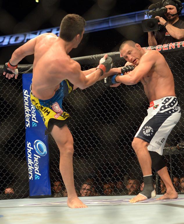 . Lyoto Machida battlesf Dan Henderson during their UFC 157 match at the Honda Center in Anaheim Saturday, February  23, 2013. Machida won the fight via judges decision. (Hans Gutknecht/Staff Photographer)
