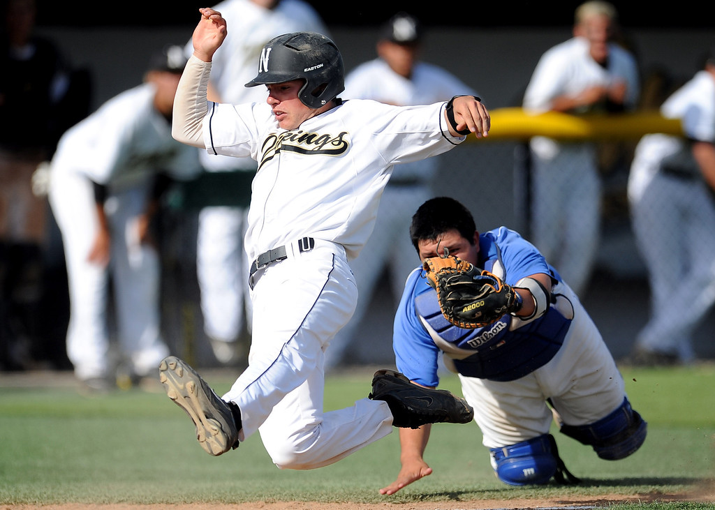 Description of . Northview's Brian Centeno scores past the tag by Baldwin Park catcher Daniel Escobedo on a single by Kollby Oriti (not pictured) in the fourth inning of a prep baseball game at Northview High School on Tuesday, April 23, 2012 in Covina, Calif. Northview won 8-2.    (Keith Birmingham/Pasadena Star-News)