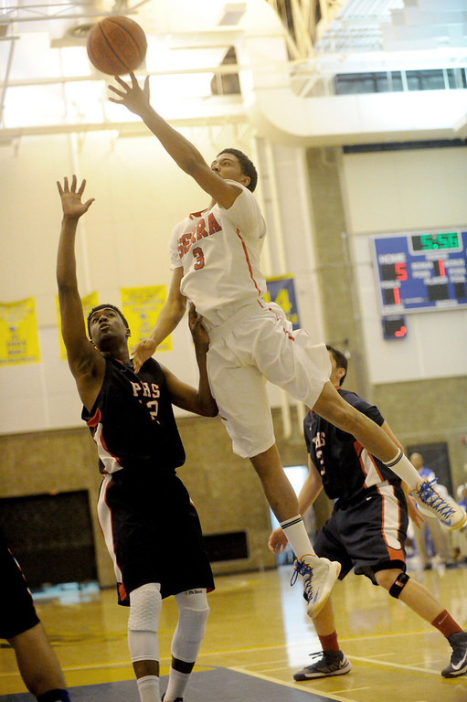 . 03-12-2013--(LANG Staff Photo by Sean Hiller)-Serra\'s Roland Wyatt (3) goes to the basket against Pacific Hills\' Namon Wright (12) in Tuesday\'s boys basketball IV Southern California Regional semifinal at L.A. Southwest College..