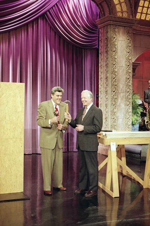 ". Former U.S. President Jimmy Carter and ""The Tonight Show\"" host Jay Leno discuss hammers during taping of the show at the NBC Studios in Burbank, Calif., Thursday, Feb. 5, 1993. Carter demonstrated his carpentry ability for Leno and when asked by Leno of President Clinton\'s building skills Carter replied, \""I hope he\'s a better statesman.\"" (AP Photo)"
