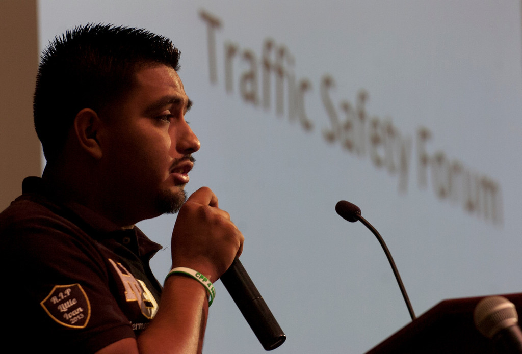 Description of . 0419_NWS_IDB_L-TRAFFIC-01-JCM (Jennifer Cappuccio Maher/Staff Photographer) Cal Poly student Diego Castro, of Los Angeles, asks for a moment of silence for Ivan Arturo Aguilar during a traffic safety forum Thursday, April 18, 2013, at Cal Poly Pomona in Pomona. Aguilar was hit by a car and killed on campus while riding his bicycle on Kellog Drive in February.
