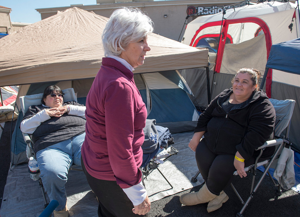. Chick-fil-A contestant Naomi Paris, center, of Alta Loma camps out at the company\'s new Azusa location to receive 52 free-meal coupons Feb. 20, 2013.  Contestants waiting for the day and staying overnight are treated to games and free meals.  (SGVN/Staff photo by Leo Jarzomb)
