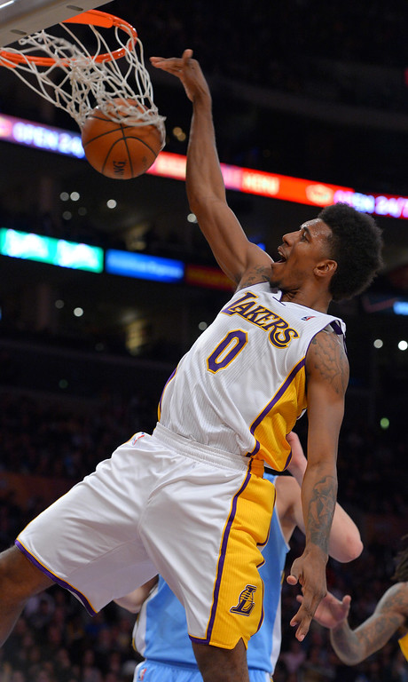 . Lakers Nick Young dunks against the Nuggets at the Staple Center in Los Angeles, CA on Sunday, January 5, 2014. 1st half.  (Photo by Scott Varley, Daily Breeze)
