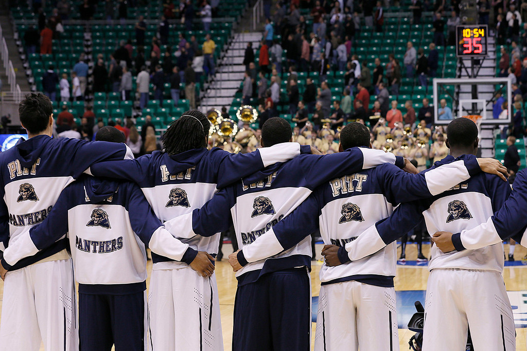 . Pittsburgh\'s players stand for the National Anthem before their game with Wichita St. in the second round of the NCAA college basketball tournament in Salt Lake City Thursday, March 21, 2013. (AP Photo/George Frey)