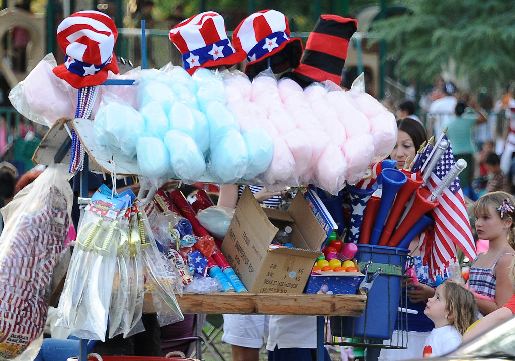 . July 4,2013 Woodland Hills. Kids check out the cotton candy  during the July Fourth Fireworks Extravaganza: Keyes Automotive Group co-sponsors the event with music by the Los Angeles Pierce Symphonic who performed  Photo by Gene Blevins/LA Daily News
