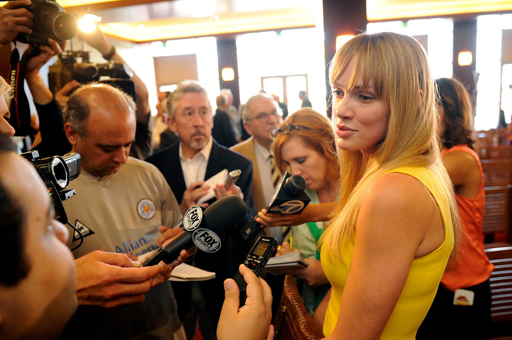 . Amanda Marcum Enfield, the wife of Andy Enfield, USC\'s new men�s basketball coach, is interviewed by reporters following a press conference, Wednesday, April 3, 2013. (Michael Owen Baker/Staff Photographer)