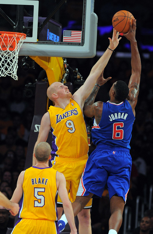 . Clippers DeAndre Jordan shoots over the block of Chris Kaman in the NBA season opener between the Lakers and Clippers at Staples Center in Los Angeles, CA on Tuesday, October 29, 2013.   (Photo by Scott Varley, Daily Breeze)