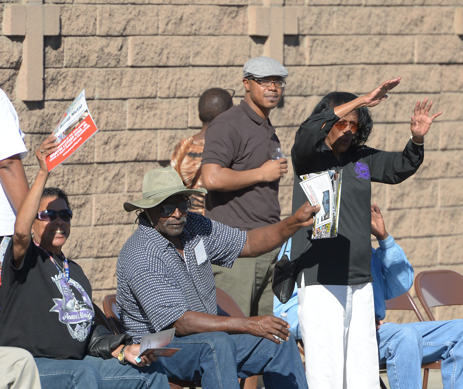 . The 26th Annual Martin Luther King, Jr., Peace & Unity Parade Saturday, January 18, 2014, Long Beach, CA.   People along the route wave to those in the parade.  Photo by Steve McCrank/Daily Breeze