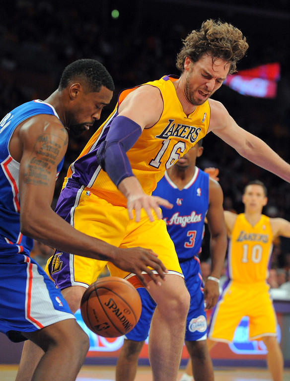 . Clippers DeAndre Jordan and Lakers Pau Gasol try to grab a loose ball  in the NBA season opener between the Lakers and Clippers at Staples Center in Los Angeles, CA on Tuesday, October 29, 2013.   (Photo by Scott Varley, Daily Breeze)