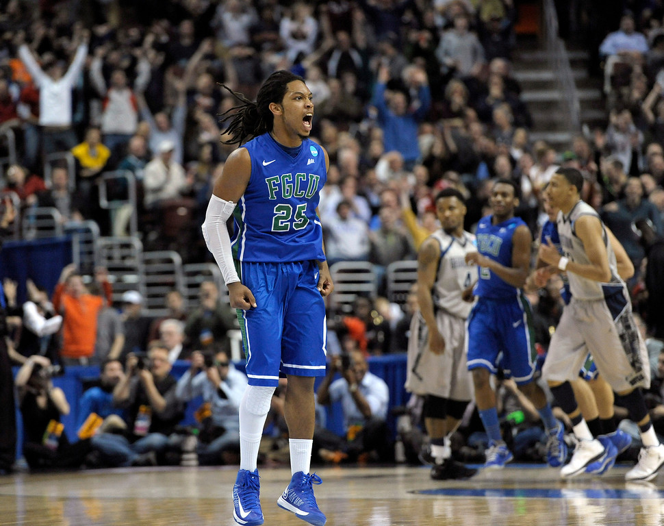. Florida Gulf Coast\'s Sherwood Brown reacts after a making a basket during the second half of a second-round game against Georgetown in the NCAA college basketball tournament, Friday, March 22, 2013, in Philadelphia. (AP Photo/Michael Perez)