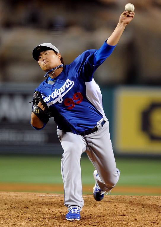 . Los Angeles Dodgers starting pitcher Hyun-Jin Ryu throws to the plate in the first inning of a spring baseball game against the Los Angeles Angels on Thursday, March 28, 2012 in Anaheim, Calif.   (Keith Birmingham/Pasadena Star-News)