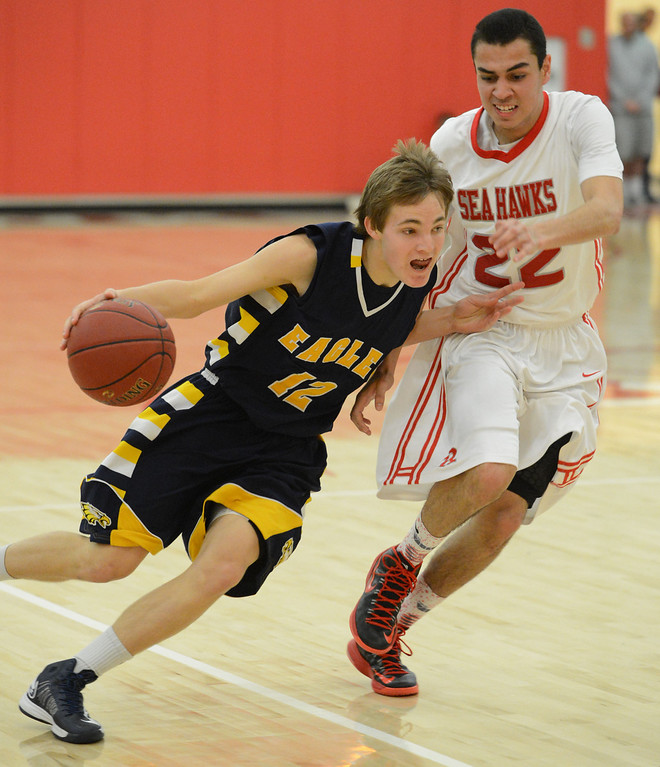 . Arroyo Grande\'s Carson Wack (12) drives his way to the basket against Redondo Union\'s Chris Henderson (22) in a CIF Southern Section Division II-A semifinal boys basketball game Tuesday night in Redondo Beach.  Redondo won the game 55-41 and advances to the title game. 20130226 Photo by Steve McCrank / Daily Breeze