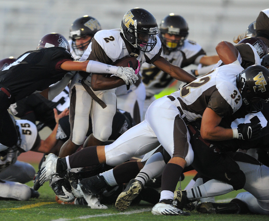 . West High takes on Torrance in a non league football game at Zamperini Stadium in Torrance, CA on Thursday, September 12, 2013. On a 2-yard run, West\'s Brett Ojiyi scores in the 1st qtr. (Photo by Scott Varley, Daily Breeze)