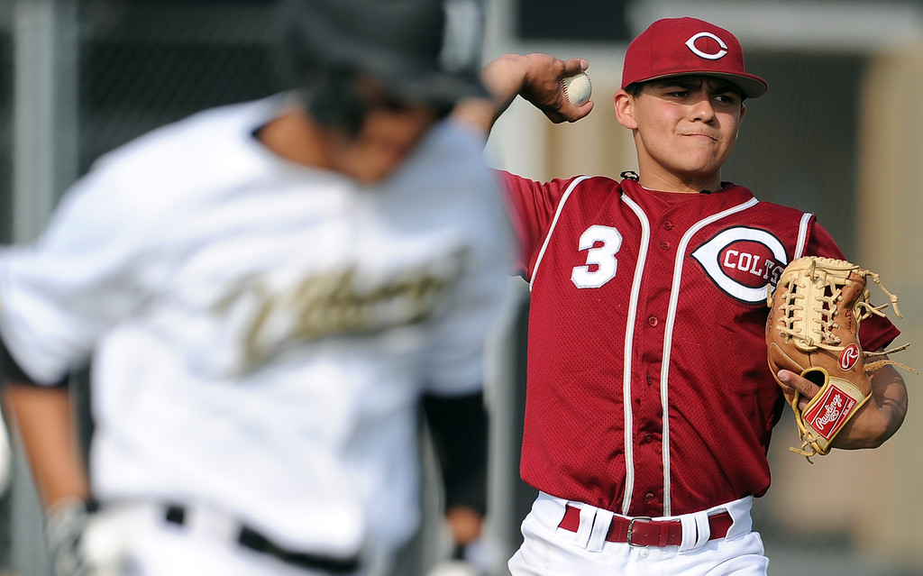 Description of . Covina starting pitcher Jonathan Cruz throws out Northview's Adrian Sabatino on the sac ground ball in the fourth inning of a prep baseball game at Northview High School on Tuesday, March 19, 2013 in Covina, Calif. Covina won 4-3.  (Keith Birmingham Pasadena Star-News)