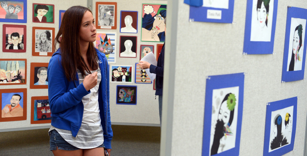 . Rachel Booth, 15 of Upland, attends her fellow students art show as Upland High School\'s visual and performing arts students showcase their work during their annual show in Upland April 26, 2013. (Thomas R. Cordova/Staff Photographer)
