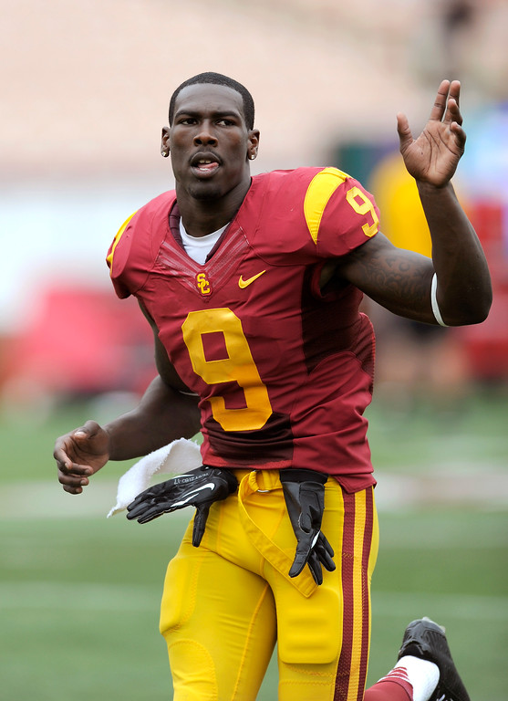 . WR Marqise Lee waves to fans during USC\'s Spring Football Game at the L.A. Memorial Coliseum, Saturday, April 13, 2013. (Michael Owen Baker/Staff Photographer)
