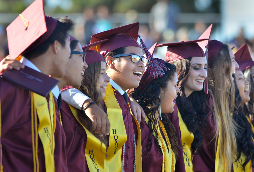 . Graduates sing Alma Mater at end of graduaton.Torrance High School Commencement Ceremony 2013 Zamperini Stadium.  Photo by Brad Graverson 6-19-13