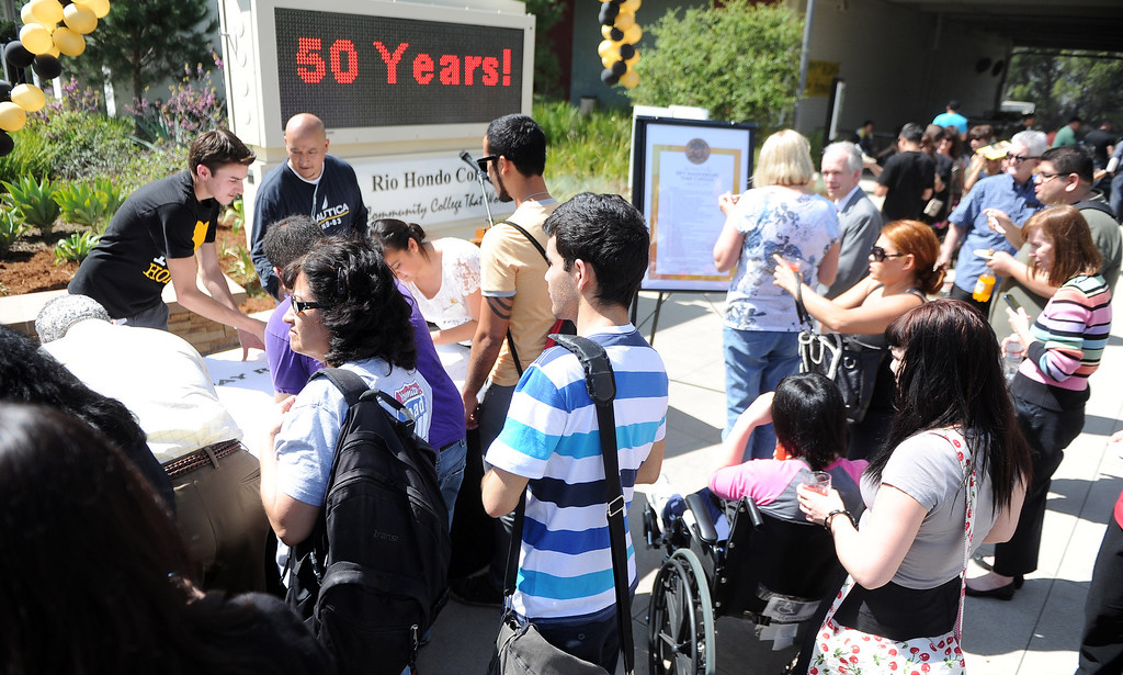 . Students and teachers sign a birthday card during a celebration of the Rio Hondo Colleges 50th anniversary with a time capsule burial, cake at Rio Hondo College on Thursday, March 14, 2013 in Whittier, Calif.  (Keith Birmingham Pasadena Star-News)