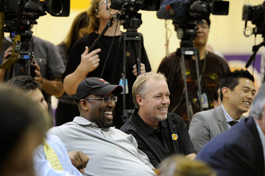 . Lakers head coach Mike Brown, left, and Lakers vice-president Jim Buss laugh when new guard Steve Nash was asked about his relations with Brown, Wednesday, July 11, 2012, at the Lakers practice facility in El Segundo. (Michael Owen Baker/Staff Photographer)