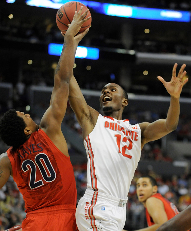 . Arizona #20 Jordin Mayes gets in front of Ohio State #12 Sam Thompson in the first half. Arizona and Ohio State met at Staples Center for the West Regional of the NCAA Division I Men\'s Basketball Championships. Los Angeles,CA 3/28/2013(John McCoy/Staff Photographer