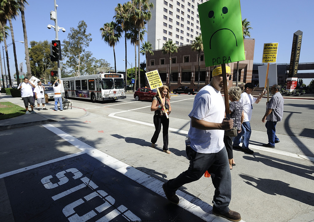 . LONG BEACH, CALIF. USA -- Dock workers as they protest the Pacific Maritime Association (PMA) handling of their health care benefits on Monday, July 8, 2013, in Long Beach, Calif.  Photo by Jeff Gritchen / Los Angeles Newspaper Group