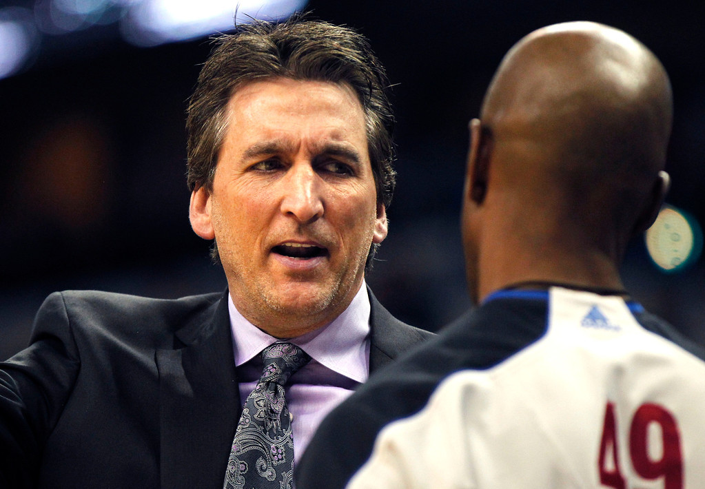 . Los Angeles Clippers head coach Vinny Del Negro, left, talks to an official in the first half of an NBA basketball game against the New Orleans Hornets in New Orleans, Wednesday, March 27, 2013. (AP Photo/Gerald Herbert)