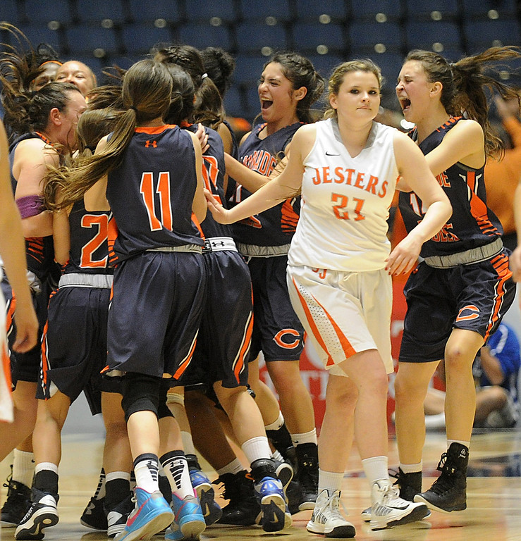 . 02-27-2012--(LANG Staff Photo by Sean Hiller)- St Joseph\'s Caterina Parkin finds herself in the middle of Chaminade\'s celebration after the Chaminade Eagles defeated the St. Joseph Jesters 74-30 in Wednesday\'s girls basketball CIF SS Div. 3A title game at the Anaheim Convention Center Arena in Anaheim.