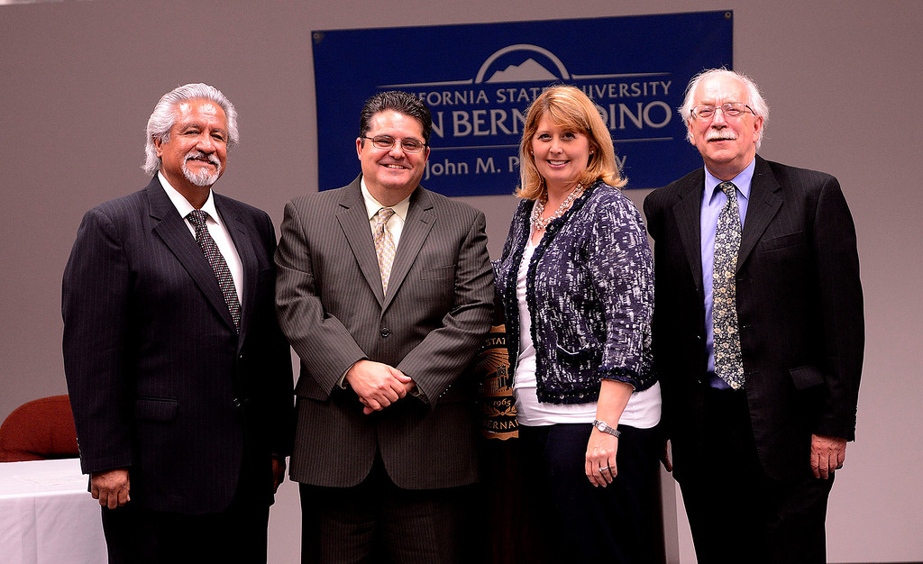 Description of . From left to right:  Dean Cesar Caballero, Los Angeles Newspaper Group Vice President Michael Anastasi, Supervisor Janice Rutherford, and Provost Andrew Bodman stand together after the transferal of The Sun's archives to the County at California State University San Bernardino April 8, 2013.   GABRIEL LUIS ACOSTA/STAFF PHOTOGRAPHER.