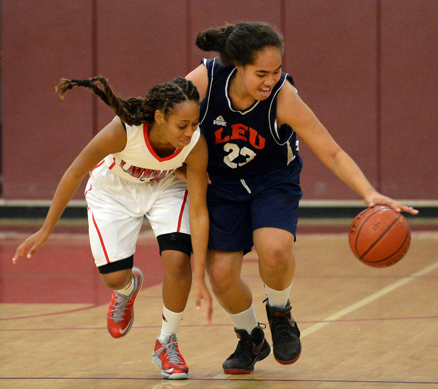 . Lawndale\'s Simone Hill (3) and Leuzinger\'s Taiana Puloka (23) battle each other for a loose ball in a girls basketball game at Lawndale High Tuesday, December 10, 2013, in Lawndale, CA.  Photo by Steve McCrank/DailyBreeze