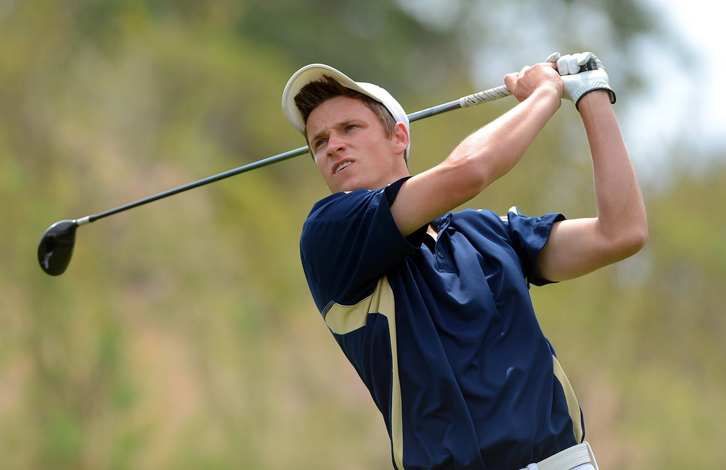 . West Ranch High School\'s Joey Downey hits a shot off the tee while competing in the final round of the Foothill League Newhall Cup golf tournament at TPC Valencia April 24, 2013.(Andy Holzman/Staff Photographer)