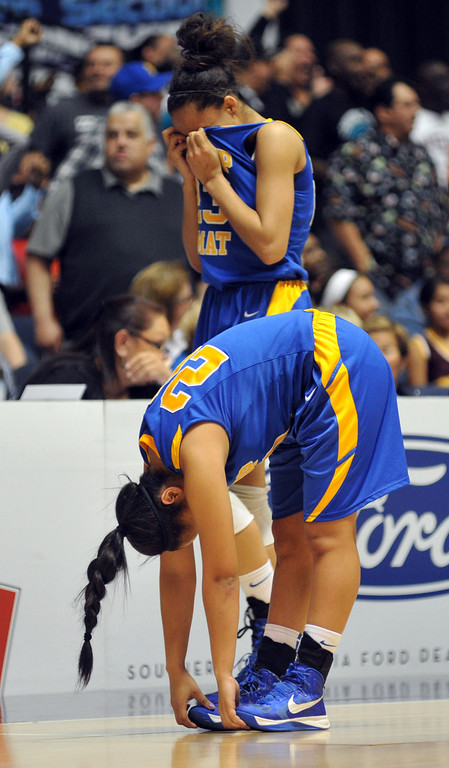 Description of . Bishop Amat players react to their loss to Canyon Springs in the CIF-SS Division 1A girls basketball finals at the Anaheim Arena on Friday February 28, 2013. Canyon Springs beat Bishop Amat 48-46. (SGVN/Staff Photo by Keith Durflinger)