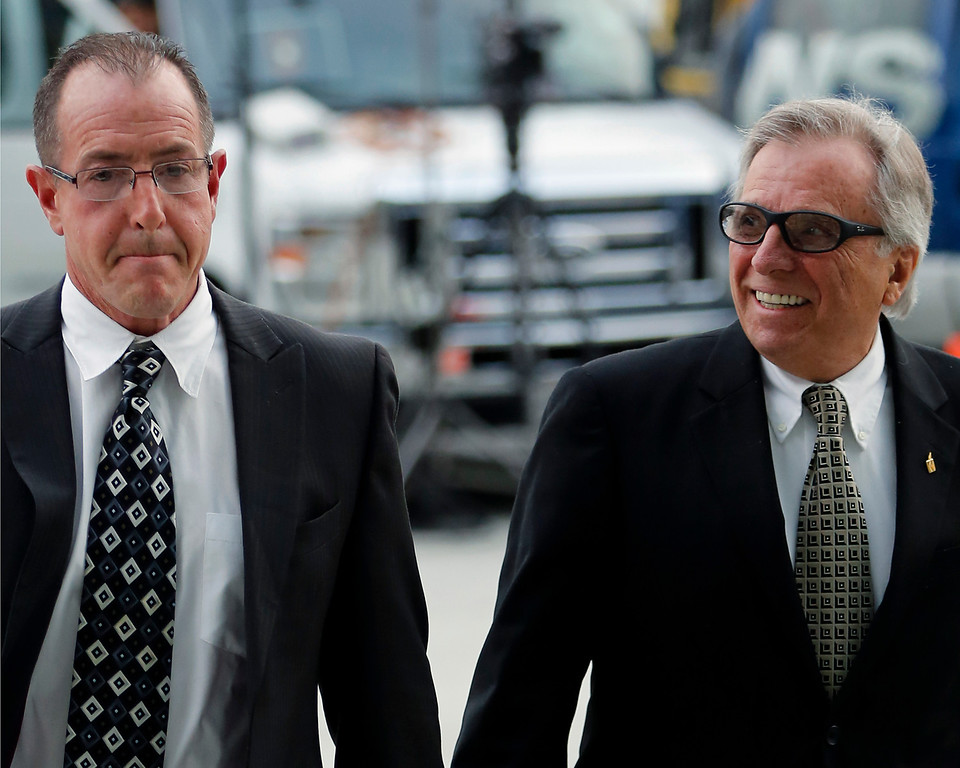 . Michael Lohan,father of actress Lindsay Lohan, left, arrives with minister Marty Angelo, president for Once Life Matters Ministries, at the Los Angeles Superior court on Monday, March 18, 2013. Lindsey Lohan is charged with three misdemeanor counts stemming from a crash on Pacific Coast Highway. She is charged with willfully resisting, obstructing or delaying an officer, providing false information to an officer and reckless driving. She is also accused of violating her probation in a misdemeanor jewelry theft case. (AP Photo/Damian Dovarganes)